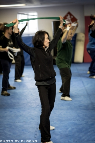 Stretching the body exercise at Xinyi-Dao Kung Fu Academy on Long Island