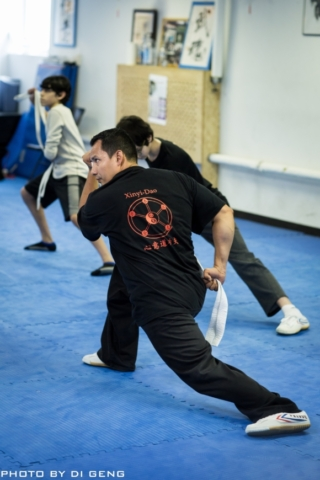 Bow stance training during class at Xinyi-Dao Kung Fu Academy on Long Island