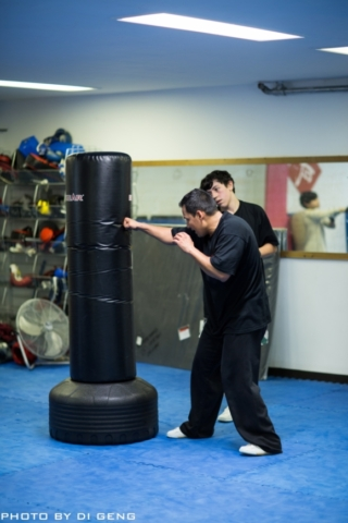 Punching bag exercies during class at Xinyi-Dao Kung Fu Academy on Long Island